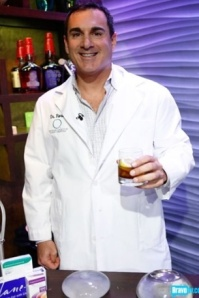 Plastic surgeon Dr.Michael Fiorillo, and his collection of implants, bartend on WWHL. Photo cred: Bravotv.com