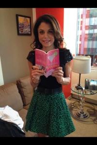 Bethenny  Frankel shows off her new book and teeny tiny frame. sourde: Bethenny Frankel Facebook