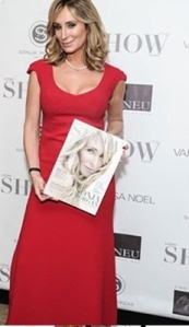 Sonja Morgan shows off her cover and dress from her upcoming line. Photo Credit: OK Magazin