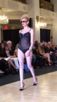 A sheer one piece swimsuit with lingerie seaming.